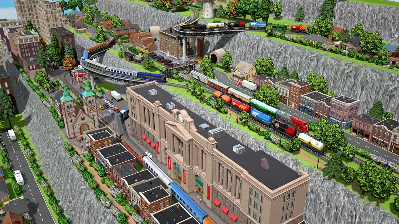 Hillside layout with more levels of buildings and tracks, containing freight and passenger trains